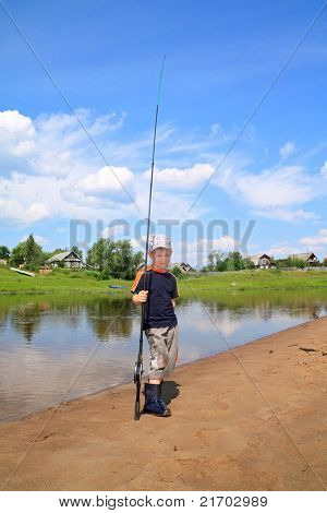boy fishes on small river