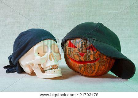 The big cheerful halloween pumpkin and skull