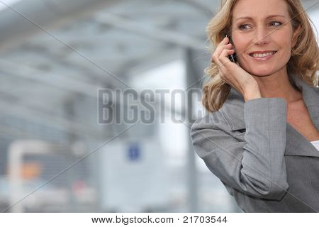Businesswoman smiling on mobile phone