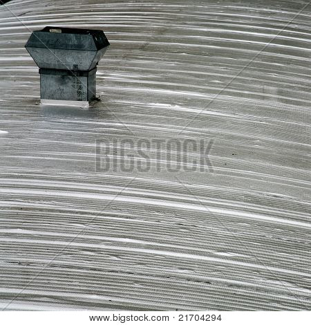 Tin Stove Pipe On Corrugated Iron Roof