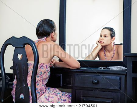 the woman looks in the mirror in vintage interior