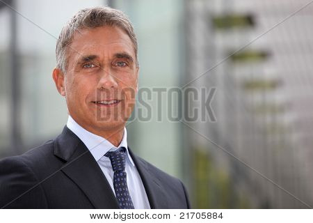 Business executive stood outdoors