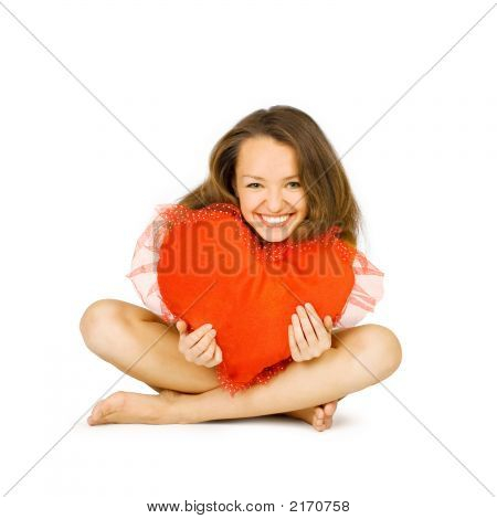 Beautiful Girl Embraces Red Heart