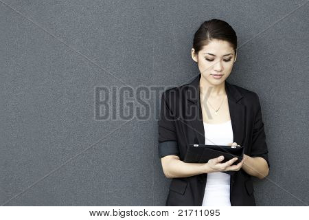 Asian Business woman using an iPad