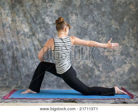 Woman Doing Yoga Posture Rotated Low Lunge Or Ashwa Sanchalanasana