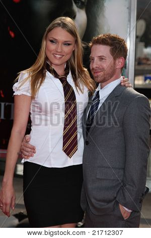 "NEW YORK, NY - JULY 11:Seth Green (R) and Clare Grant (L) arrive for the North American premiere of ""Harry Potter and the Deathly Hallows – Part 2"", July 11, 2011 at Lincoln Center in New York."