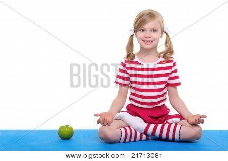 girl  with open eyesand apple  practice yoga