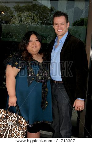 LOS ANGELES - JUL 12:  Executive Producer Yuan-Yuan Han and Tom Malloy arriving at a business luncheon at Mr. Chow on July 12, 2011 in Beverly Hills, CA
