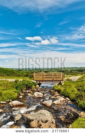 wooden footbridge over a beck