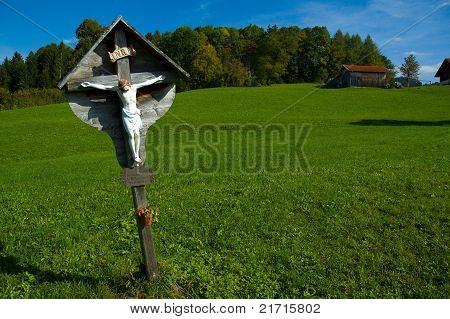Wayside Cross On A Pasture
