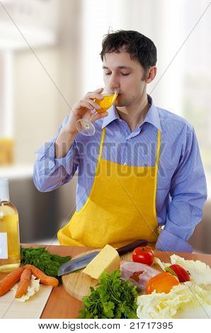 Man Cooking And Drinking White Wine