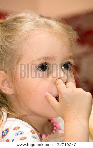Girl with finger in his nose