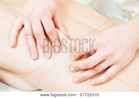 Manual medical relaxation procedure massage of human back against physical strain
