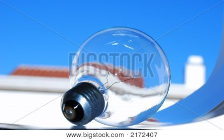 Light Bulb Blue Sky Red Roof