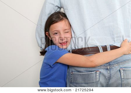Little girl putting arms around her father's waist