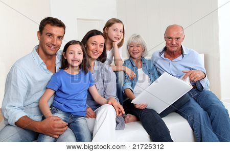 3-generation family looking at photo album