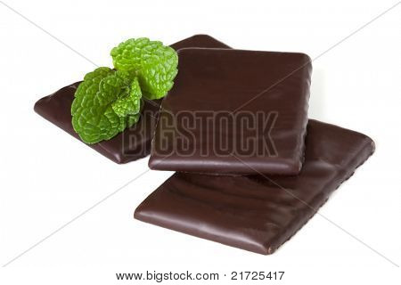 After dinner mints, with fresh mint, isolated on white.