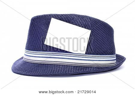 a retro blue hat with a blank label on the ribbon