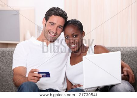 Couple shopping in-line with credit card