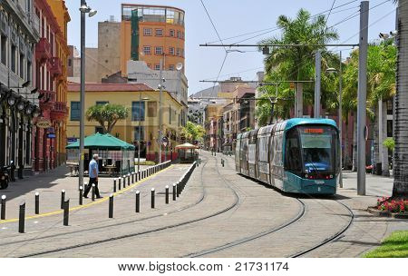 SANTA CRUZ DE TENERIFE, SPAIN - JUNE 23: Tram in a street of old town on June 23, 2011 in Santa Cruz de Tenerife, Canary Islands, Spain. Tram was opened in 2007 and it is used by 50000 people daily.