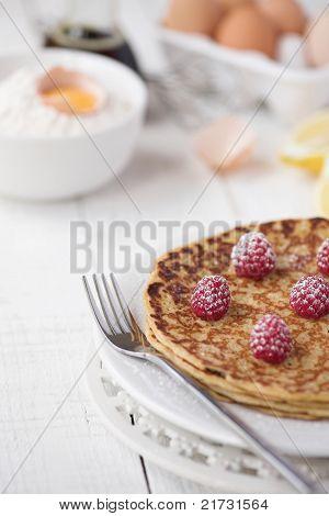 Freshly Prepared Crepes With Raspberries