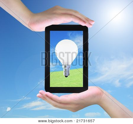 light bulb on tablet PC in women hand