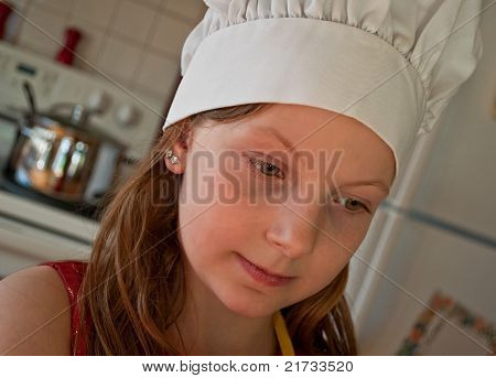 8 Year Old Caucasian Girl In Chef Hat