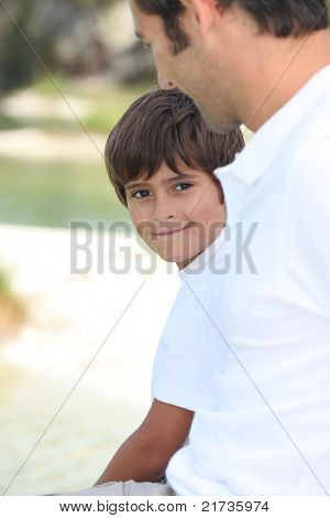 child and man watching each other