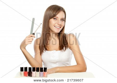 beautiful woman holding nail file