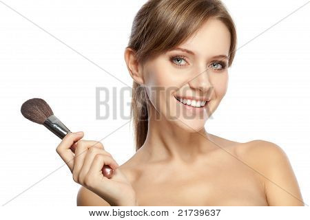 beautiful woman holding makeup brush