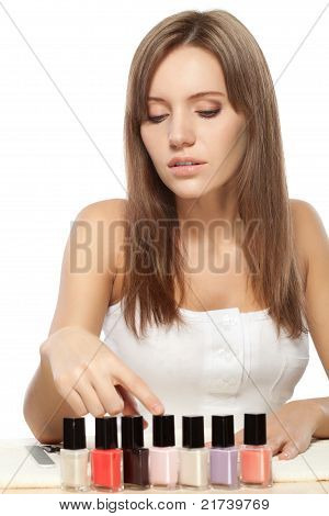 beautiful woman choosing nail polish