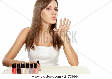 beautiful woman drying nails