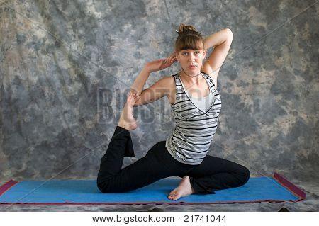 Young Woman Doing Yoga Posture Kapotasana Or Pigeon Pose Variation 3