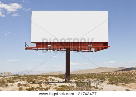 Big, blank billboard in the middle of the Mojave desert.