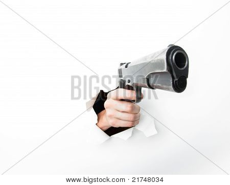 Woman's hand with big gun punching through hole