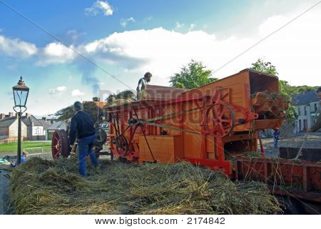 Feeding The Threshing Machine