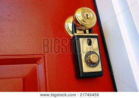 Real Estate Realtor Lock Box On House Door