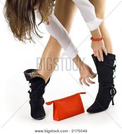 Beautiful Girl Unbuttons Or Clasps Boot