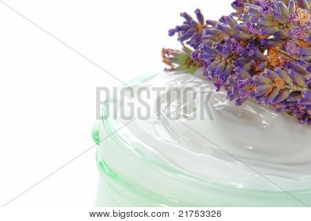 Cosmetic Cream In A Jar And Lavender Flowers