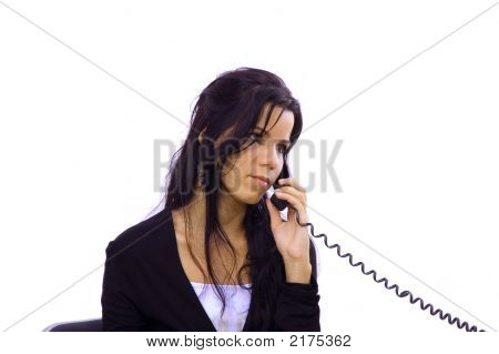 Young Receptionist Talking By Phone