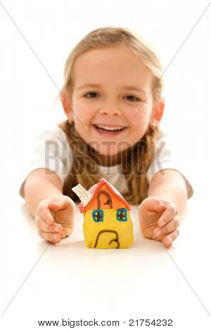 My home is protected - insurance concept with happy girl shielding her clay model house