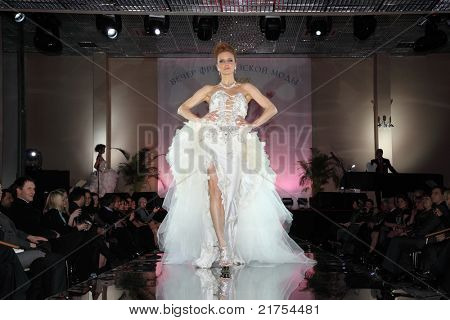 MOSCOW - FEBRUARY 14: Woman wears wedding dress at evening of French fashion in jewelry salon Estet, on February 14, 2011, Moscow, Russia. In 2006, Estet became one of leaders of Russian jewelry market