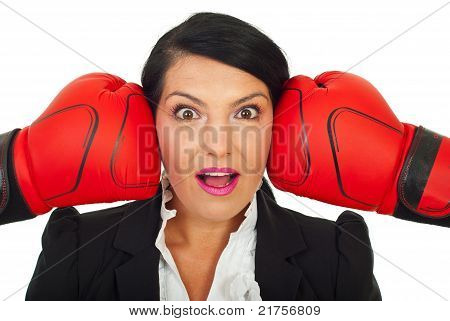 Surprised Woman Face Between Two Gloves