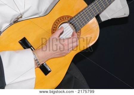 Nun Playing The Guitar