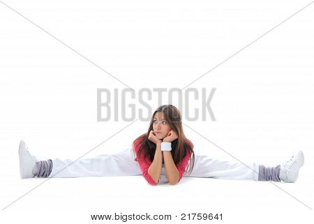 Pretty Flexible Dancer Woman Sit On Twine And Stretching On A White Background