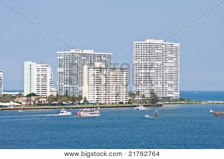 Boats Cruising Past Coastal Condos