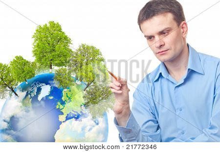 Caucasian Businessman Drawing Tree On The Earth
