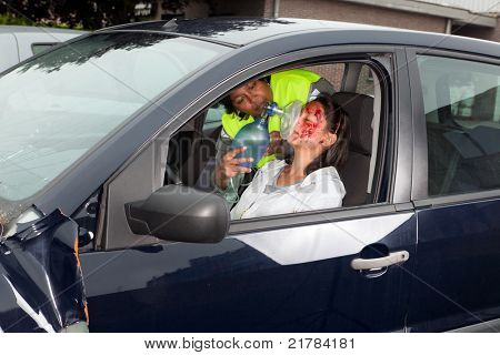 Young woman being resuscitated after a car accident