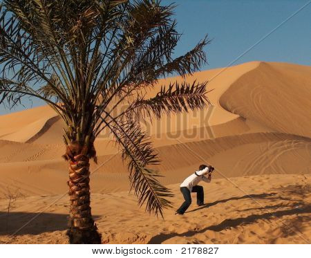 Photographer In Desert