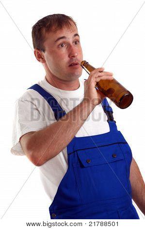 Craftsmen Drinking A Bottle Of Beer During Work Hours